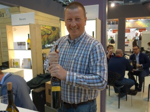 Damijan Podversic with a bottle of Ribolla Gialla 2010